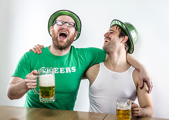 Two laughing Irish men celebrating, singing on St. Patrick's Day